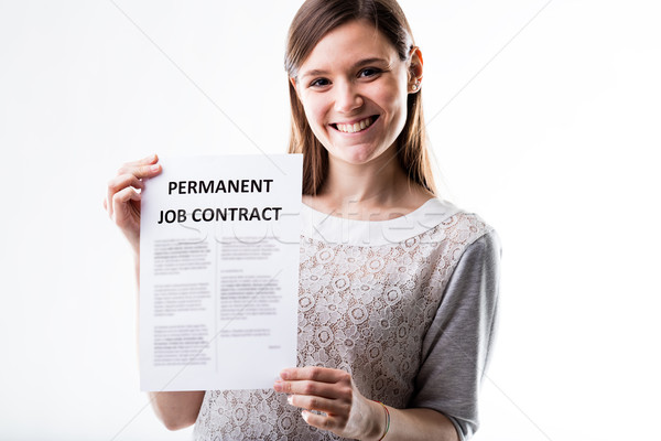 woman proudly holding her job contract Stock photo © Giulio_Fornasar