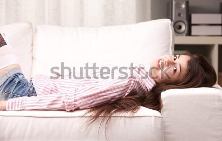 girl watching on camera lying on a sofa Stock photo © Giulio_Fornasar