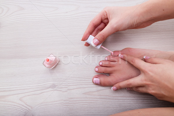 Mano mujer rosa esmalte de uñas pies Foto stock © Giulio_Fornasar
