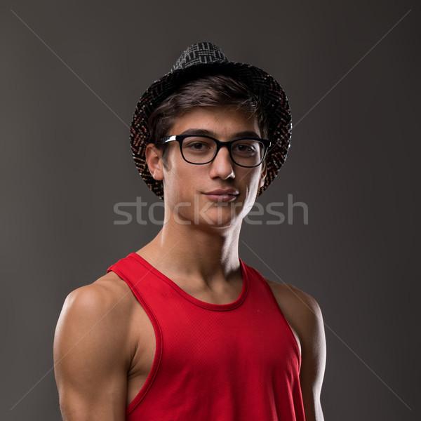 Akıllı adam gülen şapka kırmızı tank Stok fotoğraf © Giulio_Fornasar