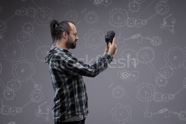 Bearded man with a pony tail taking a selfie Stock photo © Giulio_Fornasar