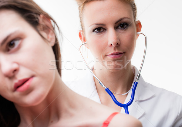 doctor examining her patient auscultating Stock photo © Giulio_Fornasar