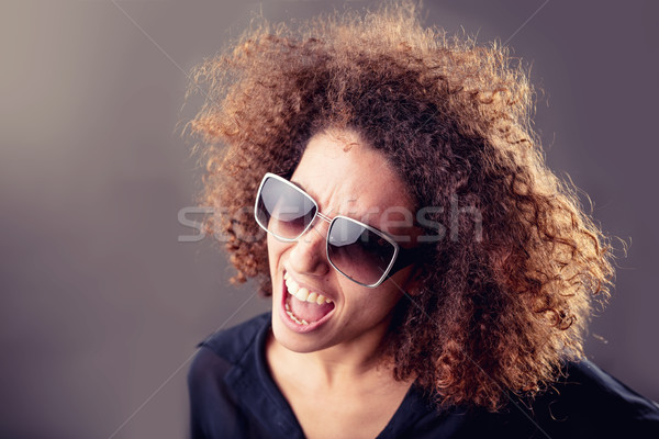 curly haired inspired young woman singing Stock photo © Giulio_Fornasar
