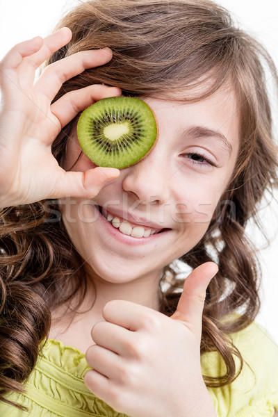 girl thumb up for kiwi green vitamins Stock photo © Giulio_Fornasar
