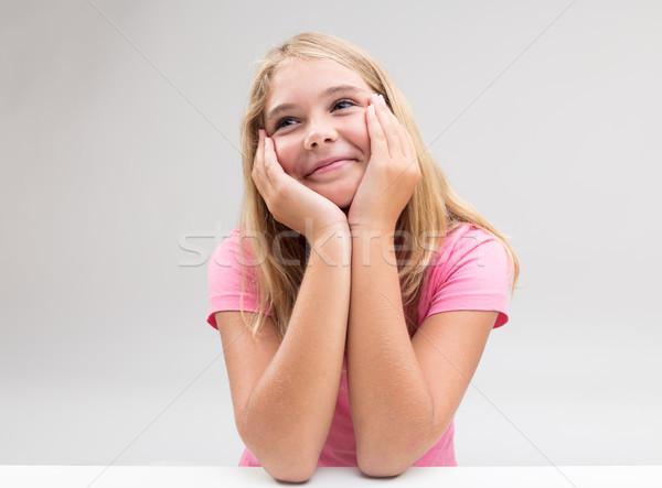 smiling girl imagining something or dreaming Stock photo © Giulio_Fornasar
