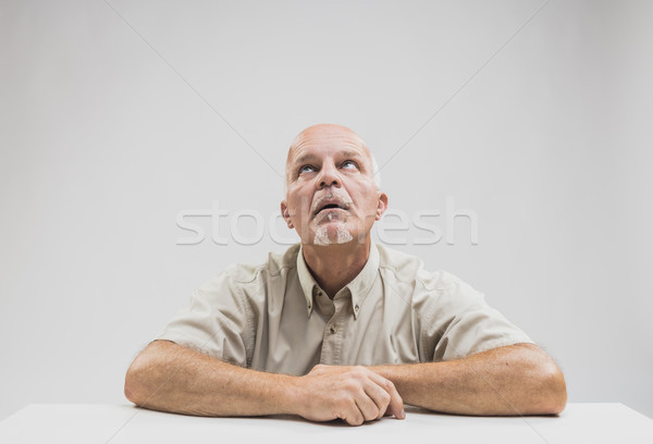 Bored man sitting at table Stock photo © Giulio_Fornasar
