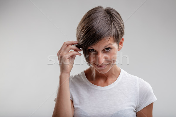 Mature woman holding aside her hair Stock photo © Giulio_Fornasar