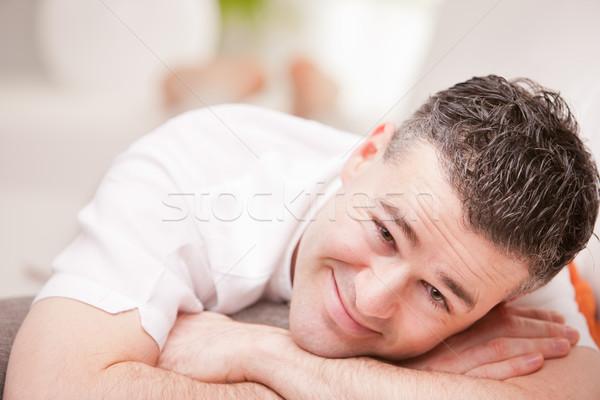 Uomo sorridere rilassante soggiorno Foto d'archivio © Giulio_Fornasar