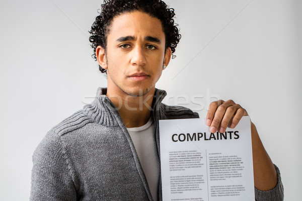 young man holding complaints report Stock photo © Giulio_Fornasar