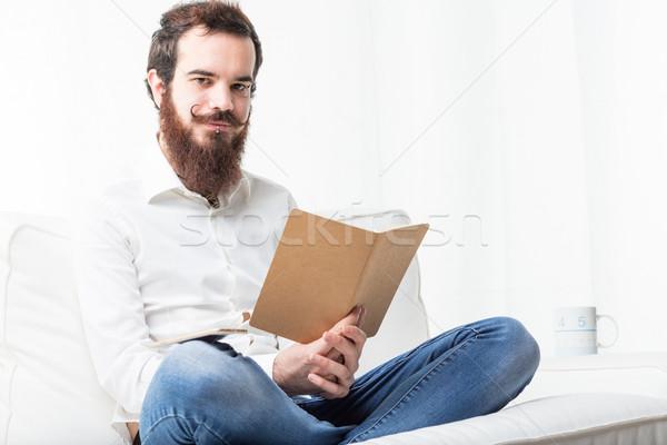 Student lezing woonkamer bank boek Stockfoto © Giulio_Fornasar
