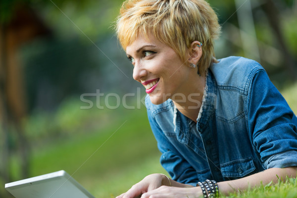 smiling woman surfing the internet outdoors Stock photo © Giulio_Fornasar