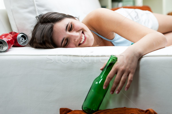 Happy drunk young woman relaxing on a sofa Stock photo © Giulio_Fornasar