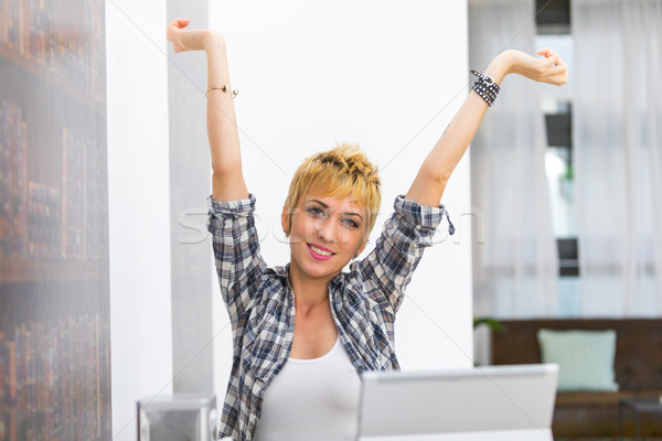 Young woman smiling with outstretched arms Stock photo © Giulio_Fornasar