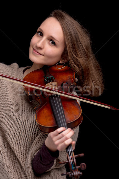 Stock photo: smiling young woman with a violin on black