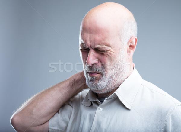 Viejo dolor dolor de cuello cuello dolor de cabeza atrás Foto stock © Giulio_Fornasar
