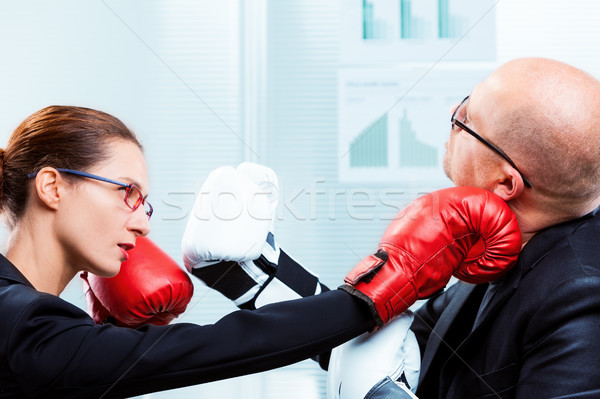 businesswoman hitting businessman's face with a punch Stock photo © Giulio_Fornasar