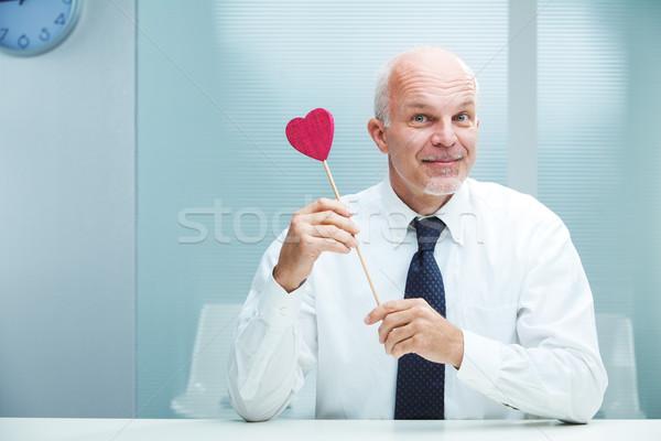 ストックフォト: 愛 · 笑みを浮かべて · ハンサム · ビジネスマン · 提供すること