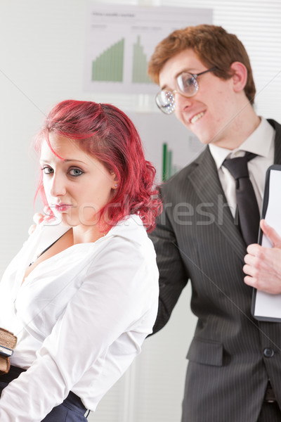 nerdy man bothering an intern woman Stock photo © Giulio_Fornasar