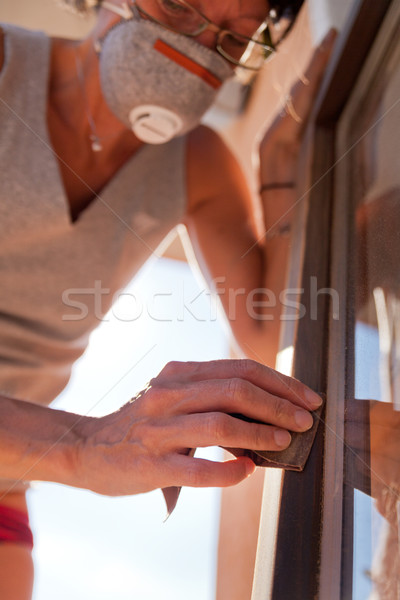 Woman polishing a window with sand Stock photo © Giulio_Fornasar