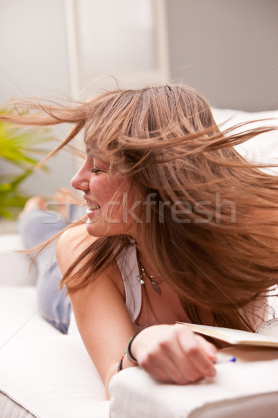girl fluttering her brown hair Stock photo © Giulio_Fornasar
