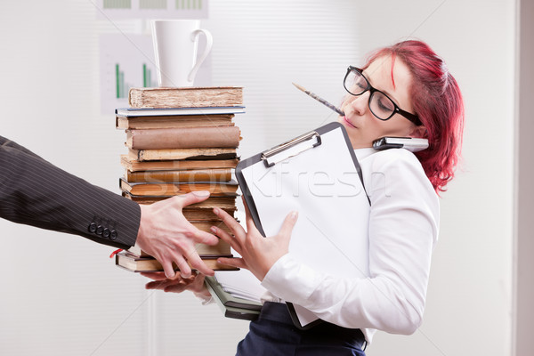 man overloading colleague woman with work Stock photo © Giulio_Fornasar