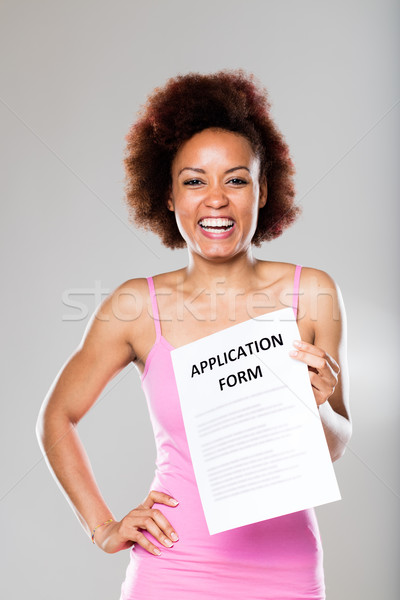 smiling woman with an application form Stock photo © Giulio_Fornasar