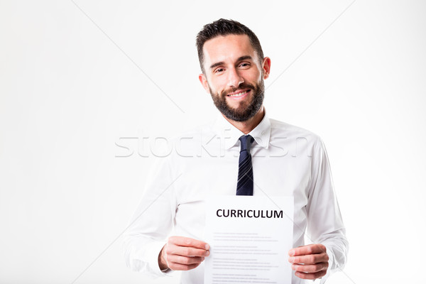 proud man showing his worthwhile resume Stock photo © Giulio_Fornasar
