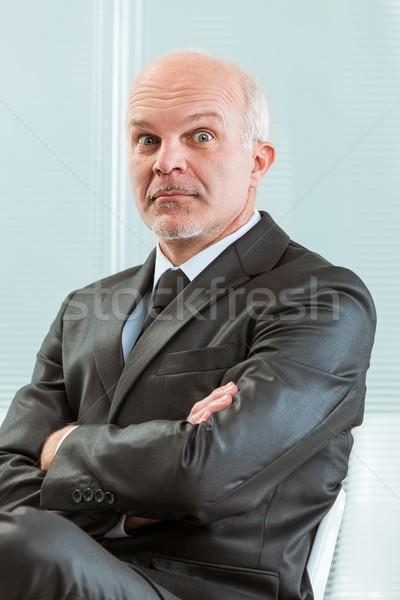 üzletember karok összehajtva vicces arc menedzser hivatalos Stock fotó © Giulio_Fornasar