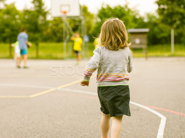 girl running towards other boys playing Stock photo © Giulio_Fornasar