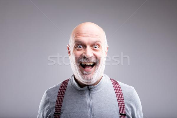 Eltúlzott idős férfi mosoly mosolyog arckifejezés férfi Stock fotó © Giulio_Fornasar