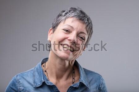 Vivacious senior woman with a lovely smile Stock photo © Giulio_Fornasar