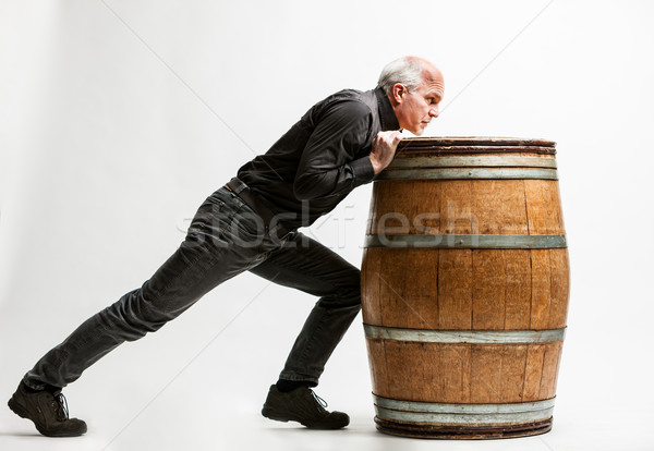 man pushing a barrel very resolute Stock photo © Giulio_Fornasar