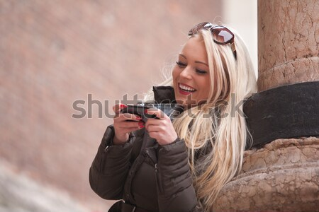 blonde girl outdoors with her mobile phone Stock photo © Giulio_Fornasar