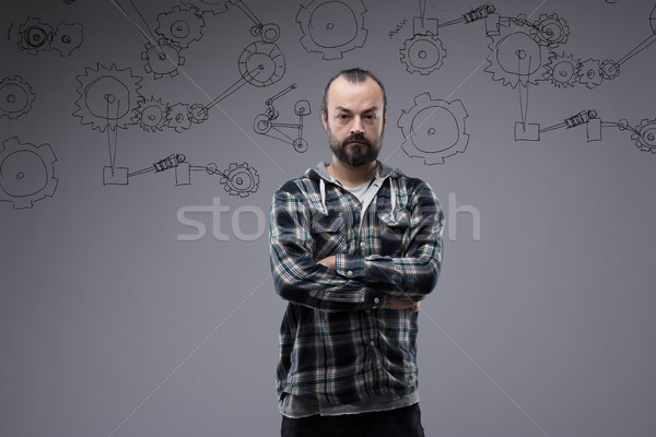 Confident bearded man with folded arms Stock photo © Giulio_Fornasar