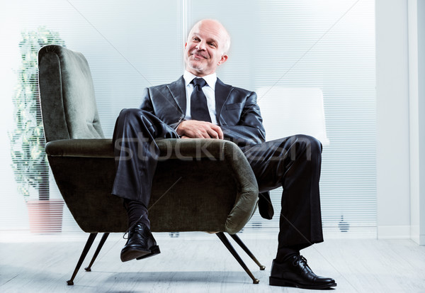 Relaxed businessman with a satisfied smile Stock photo © Giulio_Fornasar