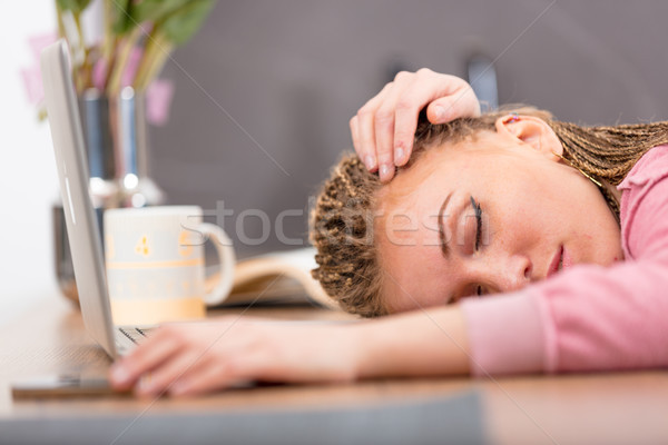 Tired attractive young woman sleeping on a table Stock photo © Giulio_Fornasar