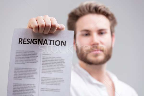Man holding up a resignation letter Stock photo © Giulio_Fornasar