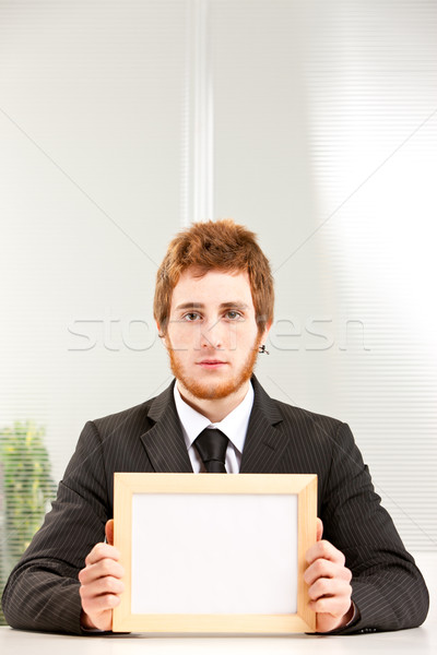 Olvas érdekes üres tábla fiatal komoly üzletember Stock fotó © Giulio_Fornasar
