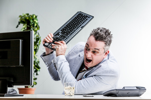office worker destroying his computer Stock photo © Giulio_Fornasar