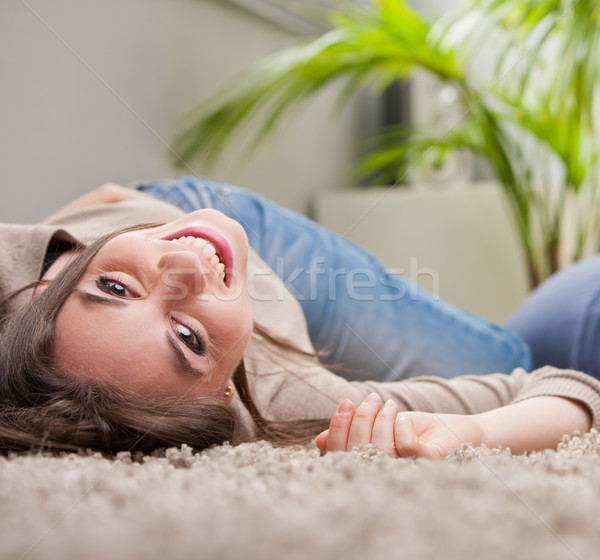young beautiful woman laughing upside-down on the floor Stock photo © Giulio_Fornasar