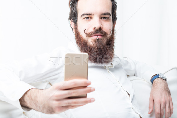 you can do it online says this bearded man Stock photo © Giulio_Fornasar