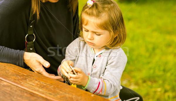 Dziewczyna gry klucze dorosły mały baby Zdjęcia stock © Giulio_Fornasar