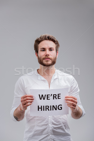Young man with We are hiring sign Stock photo © Giulio_Fornasar