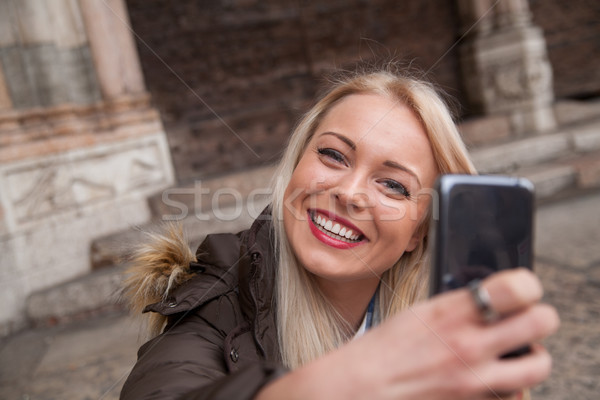 young blonde woman taking a selfie Stock photo © Giulio_Fornasar