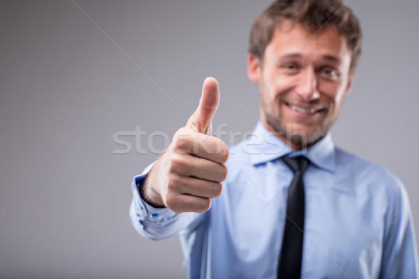 Glimlachend gemotiveerde man gebaar show Stockfoto © Giulio_Fornasar