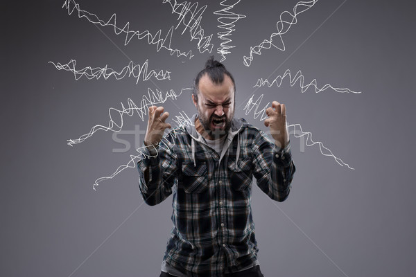 Man in a rage throwing a temper tantrum Stock photo © Giulio_Fornasar