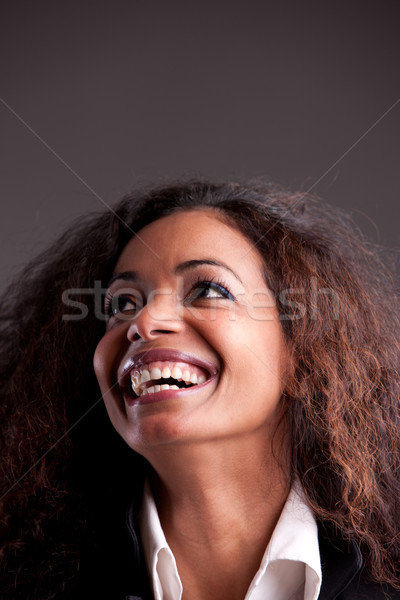 Happy afroamerican girl looking up laughing  Stock photo © Giulio_Fornasar