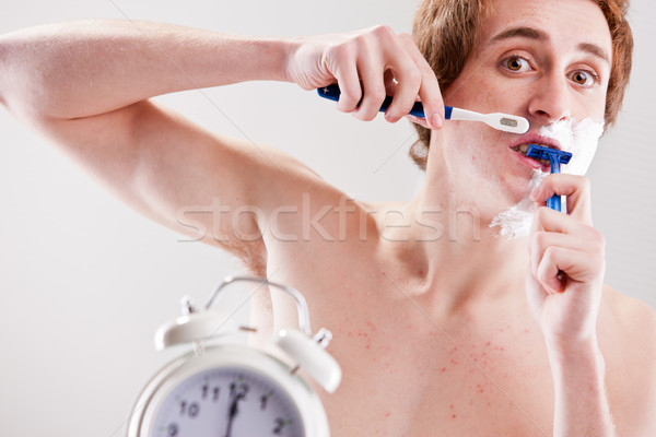 hurry up in the morning man! Stock photo © Giulio_Fornasar