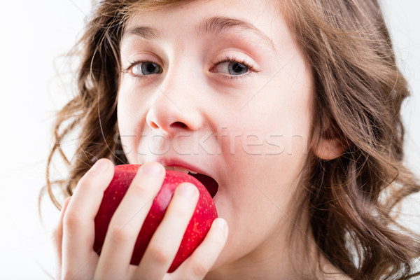 girl eats red apple on white background Stock photo © Giulio_Fornasar