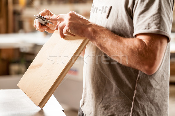 woodworker measuring with his caliper Stock photo © Giulio_Fornasar